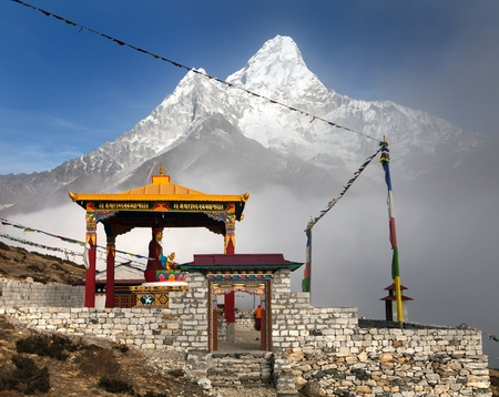 New statue of buddha in Pangboche monastery and mount Ama Dablam, Khumbu valley near Tengboche, way to Everest base camp, Nepal photo