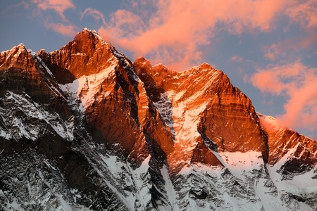 high sierra: evening view of Lhotse and clouds on the top - way to mount Everest base camp - Nepal Stock Photo