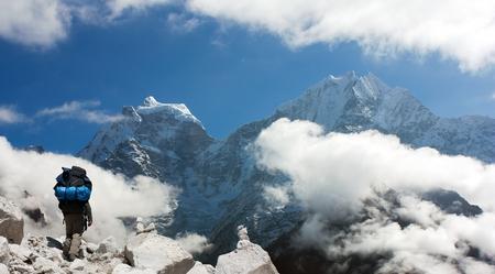 alpinist: Kangtega and Thamserku with tourist - beautiful mounts above the Namche Bazar on the way to Everest Base Camp - Nepal