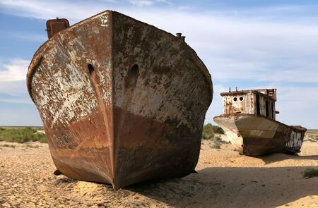 desertification: Boats in desert around Moynaq, Muynak or Moynoq - Aral sea or Aral lake - Uzbekistan - asia