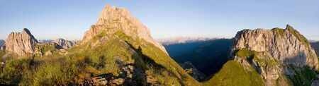 panoramatic: morning view from Karnische Alpen or Alpi Carniche - Mount Peralba and Pic Chiadenis - Sextener Dolomiten or Dolomiti di Sesto behind - Italy Stock Photo