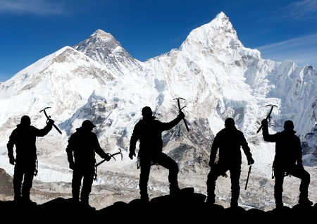 alpinism: Mount Everest from Kala Patthar and silhouette of men - trek to everest base camp - Nepal Stock Photo