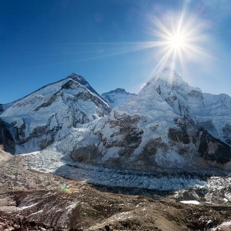 ri: Morning sun above Mount Everest, lhotse and Nuptse from Pumo Ri base camp - Way to Everest base camp - Nepal