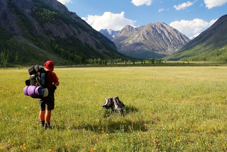 View from Altay range - Man with backpack on meadow - Karagem valley - Russia Reklamní fotografie
