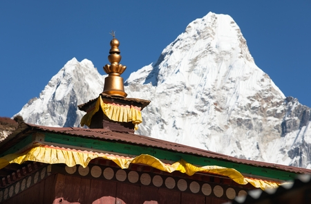 Buddhist Temple - pangboche monastery - detail of roof with mount Ama Dablam - Nepal photo