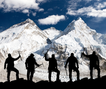 ri: Silhouette of men with ice axe in hand, Mount Everest and Lhotse from Pumo Ri base camp - way to Everest base camp - Nepal
