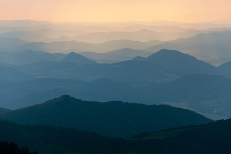 mala fatra: Evening colored view of blue horizons - view from Mala Fatra mountains to Beskyd or beskydy mountains - Karpathos mountains - Europe