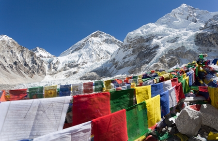 icefall: view from Mount Everest base camp with rows of buddhist prayer flags  Khumbu valley  Nepal