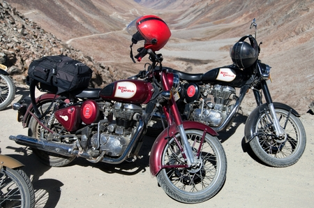 enfield: KHARDUNG LA PASS LADAKH INDIA 11th SEPTEMBER 2013  motocycles brand Royal Enfield in highest road pass on the world Khardung La Ladakh Jammu and Kashmir India Editorial
