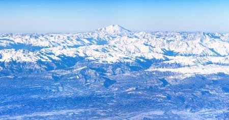 elbrus: Aerial view of Caucasus mountains and Mount Elbrus the highest European mount