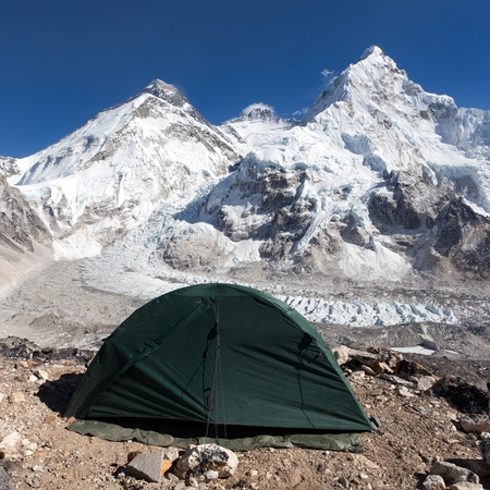 encampment: Beautiful view of mount Everest Lhotse and nuptse from Pumo Ri base camp with green tent  way to Everest base camp  Sagarmatha national park  Nepal Stock Photo