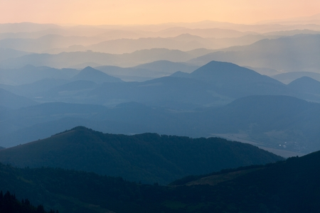 mala fatra: Evening colored view of blue horizons  view from Mala Fatra mountains to Beskyd or beskydy mountains  Karpathos mountains  Europe