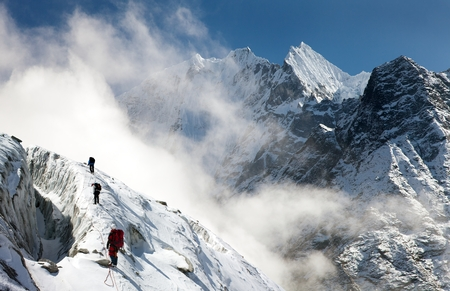 mounts: group of climbers on mountains montage to mounts Kangtega and Thamserku Everest area Khumbu valley Nepal