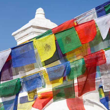 sacral symbol: Prayer flags around Bodhnath stupa in Kathmandu, Nepal