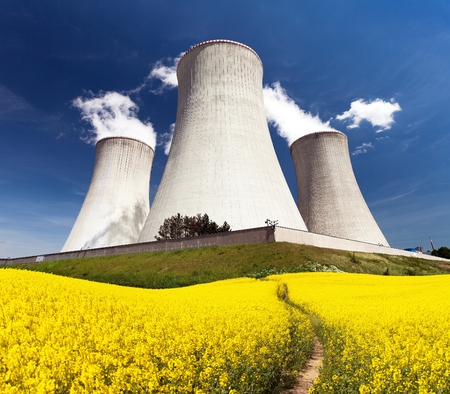 dukovany: Nuclear power plant Dukovany with golden flowering field of rapeseed - Czech Republic - two possibility for production of energy Editorial