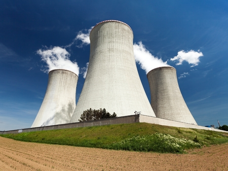 dukovany: Nuclear power plant Dukovany - cooling towers, field and beautiful sky - Czech Republic Stock Photo