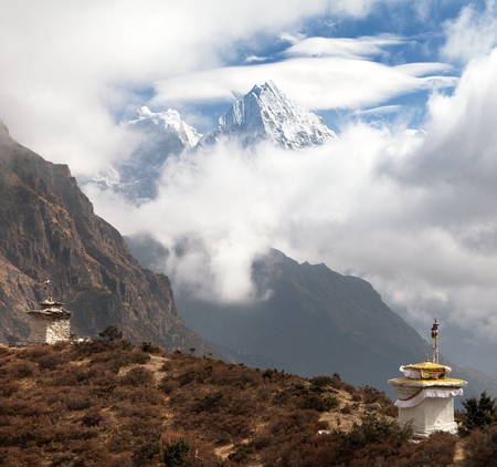 bazar: mounts Kangtega and Thamserku near Namche Bazar with stupas and beautiful clouds, Khumbu valley, Solukhumbu, Sagarmatha national park, Nepal Stock Photo