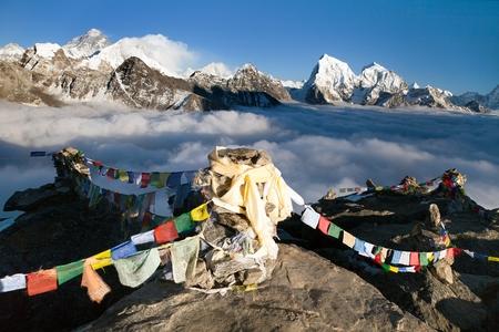 Panoramic view of Mount Everest, Lhotse and Makalu from Gokyo Ri vith prayer flags - Khumbu valley, sagarmatha national park - Nepal Stock Photo