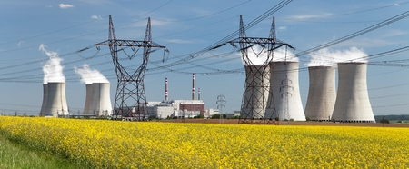 dukovany: Nuclear power plant Dukovany with golden flowering field of rapeseed - Czech Republic - two possibility for production energy