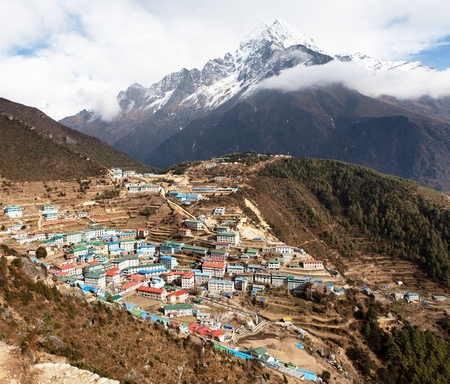 bazar: View of Namche bazar and mount thamserku - way to everest base camp, Khumbu valley, Sagarmatha national park, Solukhumbu, Nepal Stock Photo