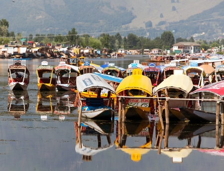 whiff: KASHMIR, INDIA, AUG 3 - Shikara boats on Dal Lake with houseboats in Srinagar - Shikara is a small boat used for transportation in the Dal lake - 3rd of August 2013, Srinagar, Jammu and Kashmir, India
