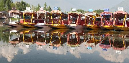 whiff: KASHMIR, INDIA, AUG 3 - Shikara boats on Dal Lake with houseboats in Srinagar - Shikara is a small boat used for transportation in the Dal lake - 3rd of August 2013, Srinagar, Jammu and Kashmir, India