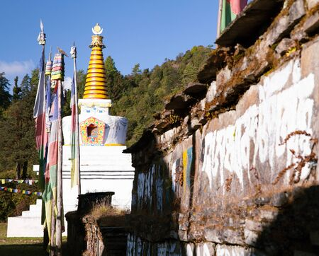 buddhist stupa: Buddhist stupa, prayer flags and Mani prayer wall, Khumbu valley, Solukhumbu, Sagarmatha national park, Nepal