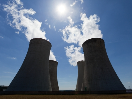 dukovany: Nuclear power plant Dukovany - cooling towers with contrejour lighting and beautiful sky - Czech Republic Stock Photo