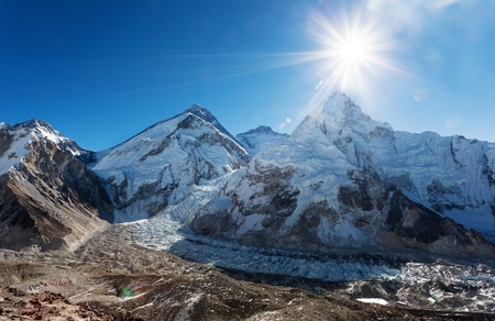 sun: Morning sun above Mount Everest, lhotse and Nuptse from Pumo Ri base camp - Way to Everest base camp - Sagarmatha national park - Nepal