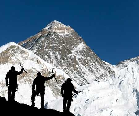 ice axe: Mount Everest from Kala Patthar from Kala Patthar and silhouette of climbing men with ice axe in hand - trek to everest base camp - Nepal