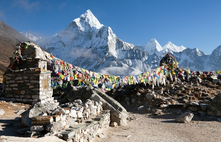 Prayer flags and mount Ama Dablam, beautiful view from Khumbu valley, Solukhumbu, way to Everest base camp - Sagarmatha national park - Nepal