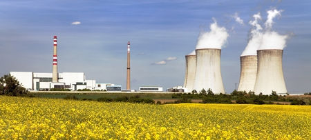 glowering: Nuclear power plant Dukovany with golden glowering field of rapeseed - Czech Republic - two possibility for production energy