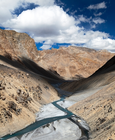 indian creek: view from Indian himalayas - mountain and river valley - way to Parang La and Takling la passes, passes from Ladakh to Himachal Pradesh - India