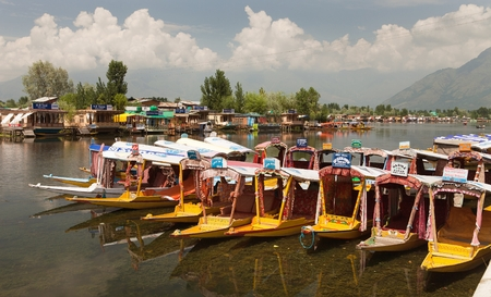 whiff: KASHMIR, INDIA - AUG 3 Shikara boats on Dal Lake with houseboats in Srinagar - Shikara is a small boat used for transportation in the Dal lake - 3rd of August 2013, Srinagar, Jammu and Kashmir, India Editorial