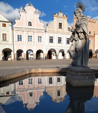 unesco in czech republic: TELC, CZECH REPUBLIC, 28TH AUGUST 2015 - view of Telc or Teltsch town square, building mirroring in public fountain with statue of st. Margaret, Czech republic. World heritage site by unesco Editorial