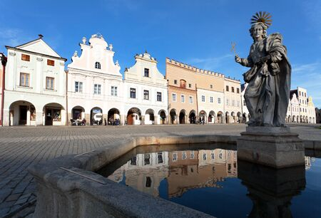 unesco in czech republic: TELC, CZECH REPUBLIC, 28TH AUGUST 2015 - Evening view of Telc or Teltsch town square, building mirroring in public fountain with statue of st. Margaret, Czech republic. World heritage site by unesco Editorial