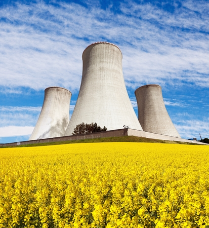 dukovany: Nuclear power plant Dukovany with golden glowering field of rapeseed - Czech Republic - two possibility for production of energy