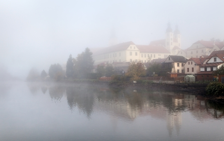 mirroring: Morning view of Telc or Teltsch town mirroring in lake Stock Photo