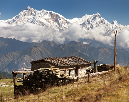 pastureland: view from Jaljala pass with chalet on pastureland and mount Annapurna - Nepal