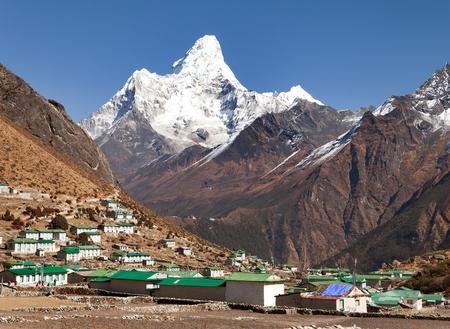 Mount Ama Dablam and Khumjung village near Namche bazar, way to Mount Everest base camp, Sagarmatha national park, Khumbu valley, Solukhumbu, Nepal Stock Photo