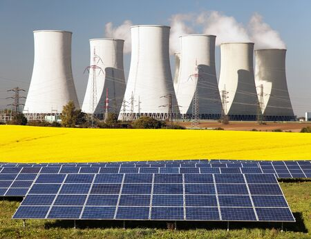 glowering: Nuclear power plant with golden glowering field of rapeseed and photovoltaic sunny power plant - Three possibility for production of electric energy