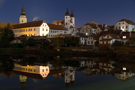 mirroring: Night view of Telc or Teltsch town mirroring in pond, Czech republic.