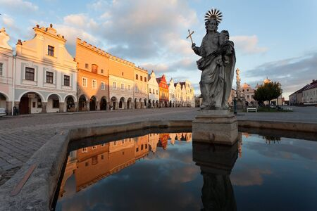 unesco in czech republic: TELC, CZECH REPUBLIC, 28TH AUGUST 2015 - Evening red colored view of Telc or Teltsch town square mirroring in public fountain, Czech republic. world heritage site by unesco
