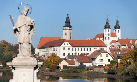unesco in czech republic: View of Telc or Teltsch town with statue of st. John of Nepomuk, UNESCO town in Czech Republic