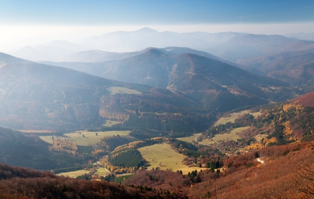 Autumnal view from mount Klak to Strazovske vrchy with blue horizons, Carpathian mountains, Slovakia