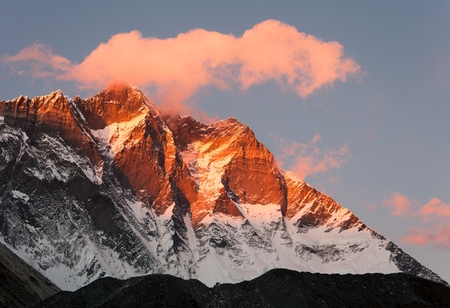 high sierra: evening view of Lhotse and clouds on the top, warm tone - way to mount Everest base camp, khumbu valley, Nepal