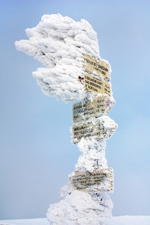 frostbitten: signpost on top of Kralicky Sneznik or Snieznik Klotzky - border of Czech Republic and Poland - water divide for Black sea, Baltic sea and North sea