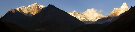 panoramatic: evening view of Ama Dablam, Lhotse, Nuptse and top of Everest - Nepal Stock Photo