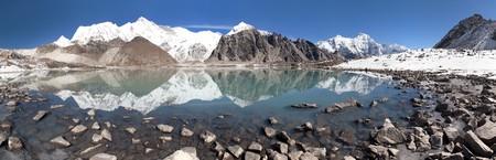 mirroring: view of mount Cho Oyu mirroring in lake - Cho Oyu base camp - Everest trek - Nepal