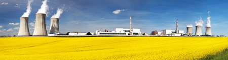 dukovany: Nuclear power plant Dukovany with golden glowering field of rapeseed - Czech Republic - two possibility for production energy